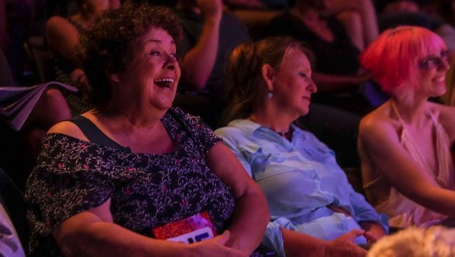 Lavinia Hart of Detroit, left, laughs as she watches the performance from students and teachers of Detroit Creativity Project during a DCP fundraiser at the Marlene Boll Theatre of Boll Family YMCA in downtown Detroit, Wednesday, August 9, 2017.
