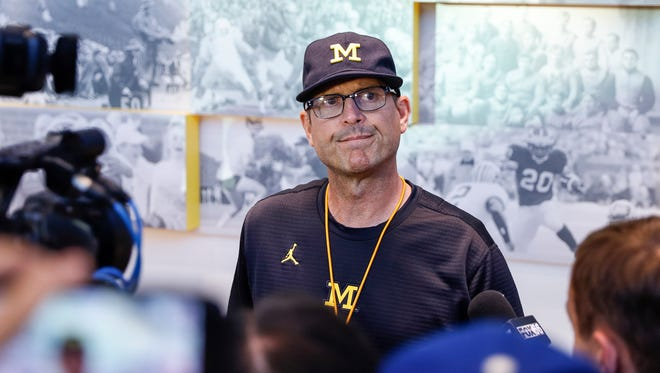 Michigan Wolverines coach Jim Harbaugh speaks with media at the Towsley Museum in Schembechler Hall in Ann Arbor, Aug. 11, 2017.