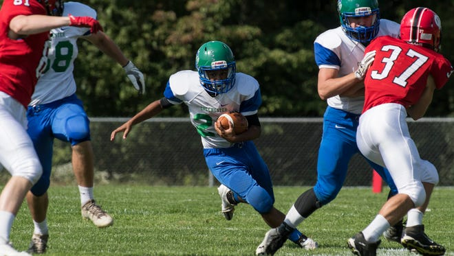 Colchester's Quentin Hoskins (28) runs with the ball during the high school football game between the Colchester Lakers and the Champlain Valley Union Redhawks on Saturday.