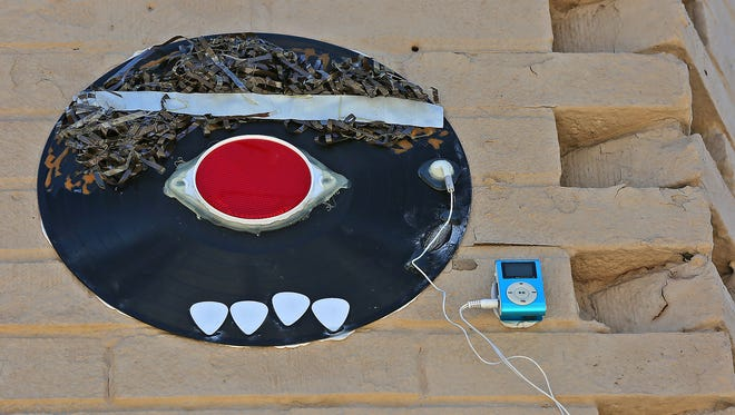 """A """"Recordface,"""" is seen, Thursday, Sept. 28, 2017, on the side of the Irving Theater.  The mysterious art installations have been seen all over town for several years.  They include MP3 players with music, though, most have been taken.  This one is still there, but hard to reach."""