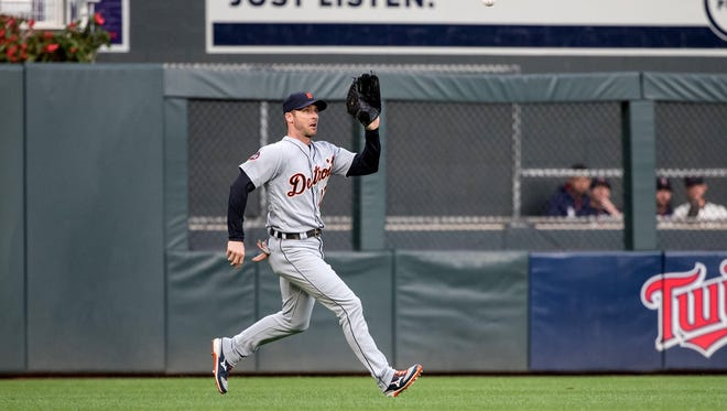 Tigers leftfielder Andrew Romine (17) fields the ball during the first inning on Saturday, Sept. 30, 2017, in Minneapolis.