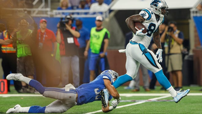 Lions safety Miles Killebrew tries to stop Panthers tight end Ed Dickson in the first half of the Lions' 27-24 loss to the Carolina Panthers at Ford Field on Sunday, Oct. 8, 2017.