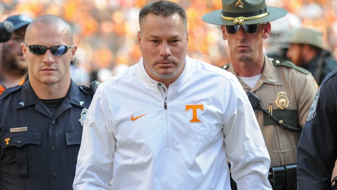 Tennessee Volunteers head coach Butch Jones leaves the field after his team lost 15-9 to the South Carolina Gamecocks at Neyland Stadium.