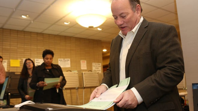 Detroit Mayor Mike Duggan casts his vote in the Detroit general elections were he is running as the incumbent mayor at the River House Apartments in Detroit on Tuesday, Nov. 7, 2017.