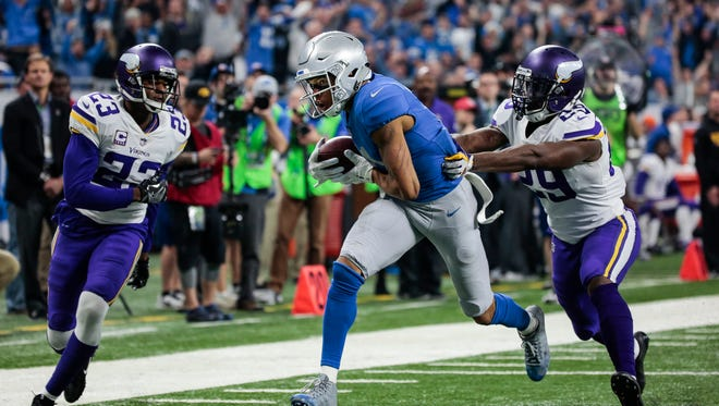 Lions receiver Marvin Jones catches a touchdown in between Vikings cornerbacks Terence Newman, left, and Xavier Rhodes in the second half.