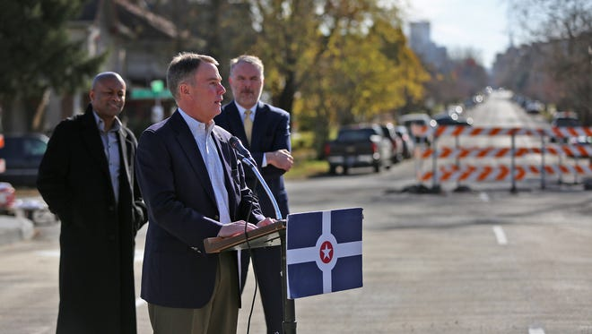 Mayor Joe Hogsett speaks during a press conference for the re-opening of the Capitol Ave. bridge, Monday, Nov. 27, 2017.