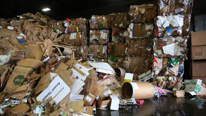 Cardboard piles up before being bundled for recycling at Garten Services in Salem on Thursday, Jan. 11, 2018.