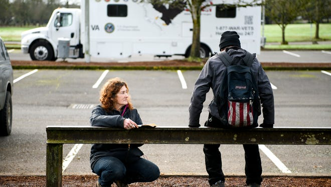 Joan, right, talks to a homeless person at Wallace Marine Park during the Point-in-Time homeless count on Wednesday, Jan. 31, 2018. A network of advocates, volunteers and non-profits conducted a survey of homeless people across Marion and Polk counties. Joan herself has lived in the park for more than five years, though she is finally getting her own place in April.