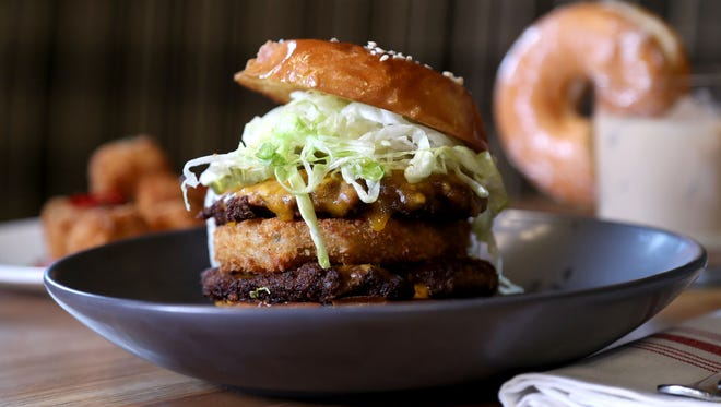 "Whiskey Dry by Ed Lee will have burgers and whiskey, of course, but with around 200 selections from around the world. There's also the ""Ed Mac,"" Lee's ""playful"" interpretation of a McDonald's Big Mac with a fried green tomato displacing the center bun of the fast food classic.  An iceburg lettuce slaw and thick Russian-style dressing echo the McDonald's predecessor."