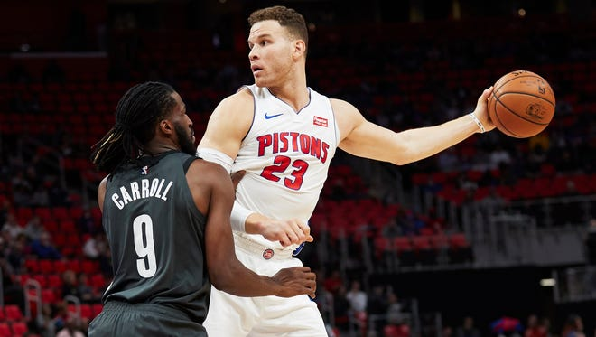 Detroit Pistons forward Blake Griffin (23) is defended by Brooklyn Nets forward DeMarre Carroll (9) in the first half at Little Caesars Arena, Wednesday, Feb. 7, 2018.