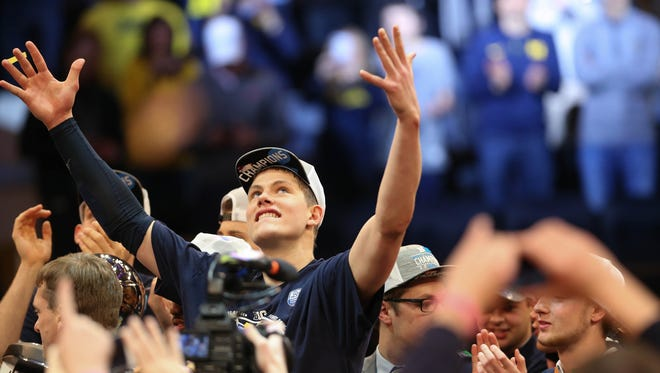 Michigan forward Moritz Wagner celebrates after winning the Big Ten Tournament Championship 75-66 over Purdue Sunday, March 4, 2018 at Madison Square Garden in New York. Kirthmon F. Dozier/Detroit Free Press