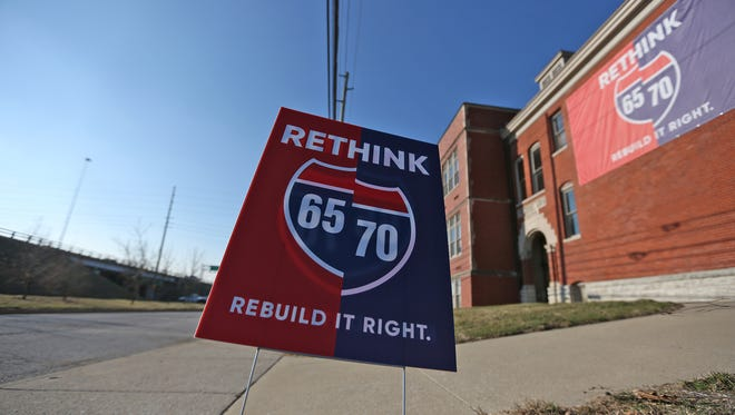 A giant Rethink 65/70 sign is seen on the Young & Laramore building, on Davidson St., across from the highway, Tuesday, March 13, 2018.