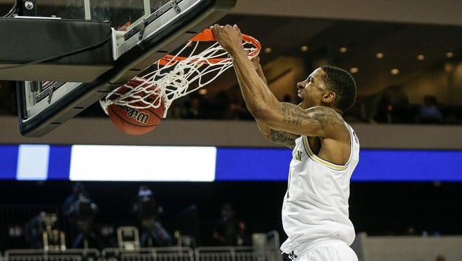 Michigan's Charles Matthews dunks against Montana during the first half of a first round NCAA tournament game in Wichita, Kan., on Thursday.