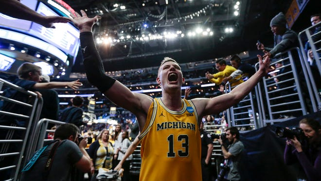 Moritz Wagner high-fives fans as he walks off the court after Michigan crushed Texas A&M, 99-72, in the Sweet 16 of the NCAA tournament in Los Angeles on Thursday, March 22, 2018.