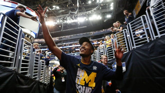 Muhammad-Ali Abdur-Rahkman waves at the Staples Center fans following Michigan's 58-54 win in the Elite Eight on March 24.