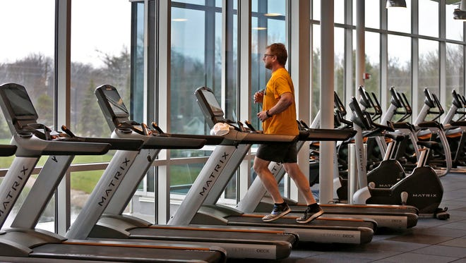 Ken Milner works out in the fitness center at the Parkwood Amenity and Recreation Center (PARC), Wednesday, April 24, 2018.