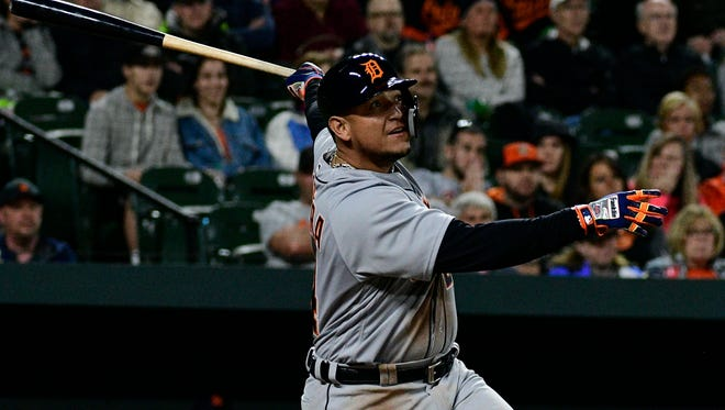 Apr 28, 2018; Baltimore, MD, USA; Detroit Tigers first baseman Miguel Cabrera hits a three-run home run during the second inning against the Baltimore Orioles at Camden Yards.