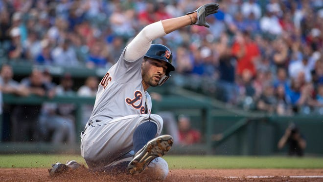 Nicholas Castellanos slides in to home plate during the third inning against the Rangers at Globe Life Park in Arlington on Monday.