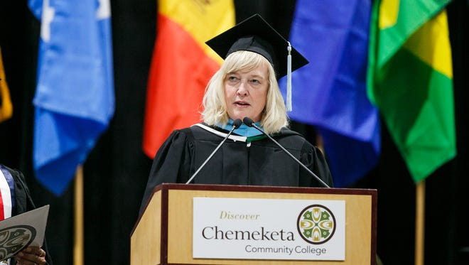 Chemeketa Community College President Julie Huckestein speaks to graduates at the 62nd annual Chemeketa Community College graduation on Friday, June 15, 2018, at the Oregon State Fairgrounds.