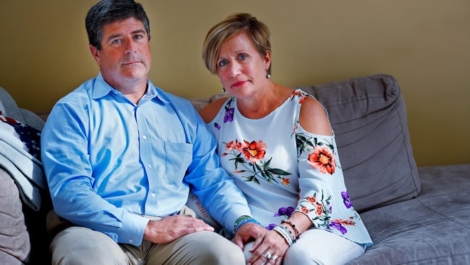 Carmel residents Chris and Marilyn McCalley discuss their son, Patrick, who died by suicide.