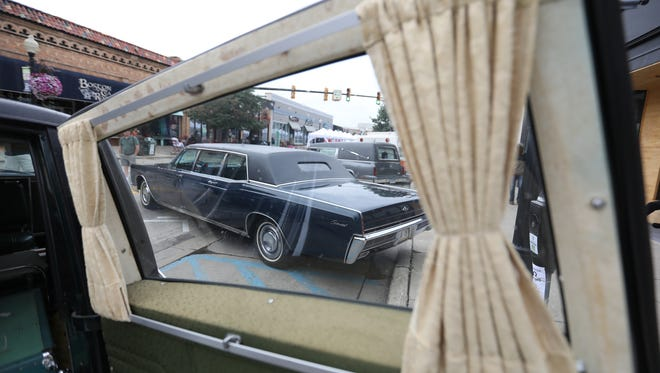 Hearses, ambulances, and flower cars line up for the emergency vehicle show in downtown Ferndale during the 2018 Professional Car Society International Meet on Friday, Aug. 17, 2018.