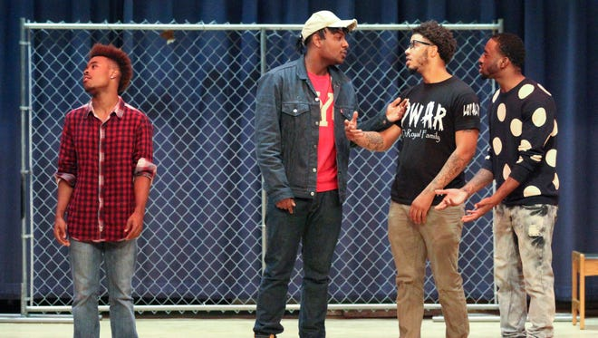 "Cast members (from left) Xavier Cole, Marsalis Cerdan, Najee Conner and Shawn Justin-Amere during a performance of ""I Should Not Be A Target"" at Stubbs Elementary School Saturday."