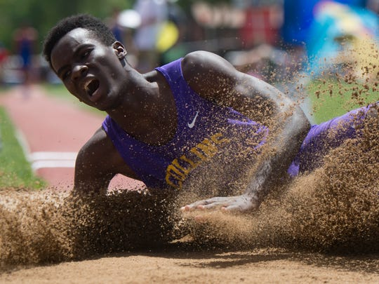 Allam Bushara of Fort Collins High School lands in the sand as he competes in the 5A long jump during the CHSAA State Track and Field Championships at JeffCo Stadium in Lakewood on Thursday, May 17, 2018.