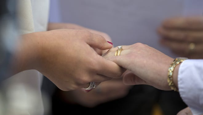 Manuel Balce Ceneta/AP Jennifer Melsop, left, 26, and Erika Turner, 26, from Centreville, Va. hold hands after exchanging wedding rings Monday in Arlington, Va. Gay-rights activists acknowledge that other difficult issues beyond marriage equality remain on their agenda. Jennifer Melsop, left, 26, and Erika Turner, 26, from Centreville, Va. hold hands after exchanging wedding rings during a ceremony officiated by Rev. Linda Olson Peebles in front of the Arlington County Courthouse in Arlington, Va., Monday, Oct. 6, 2014. The Supreme Court cleared the way Monday for an immediate expansion of same-sex marriage by unexpectedly and tersely turning away appeals from five states seeking to prohibit gay and lesbian unions. (AP Photo/Manuel Balce Ceneta)