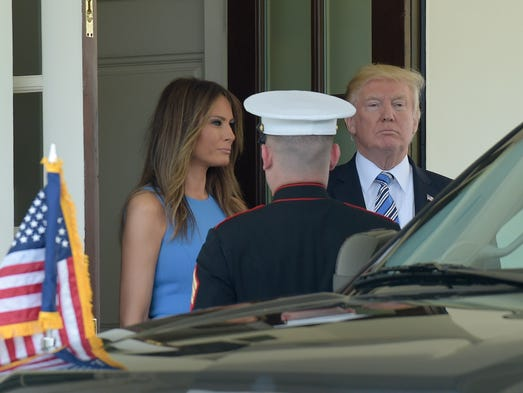 The Trumps watch as Panamanian President Juan Carlos