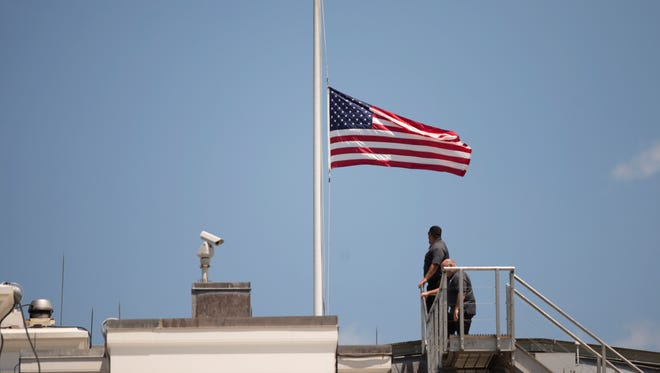 The American flag is flown at half staff over the White House last Sunday, after President Obama spoke about the massacre at an Orlando nightclub.