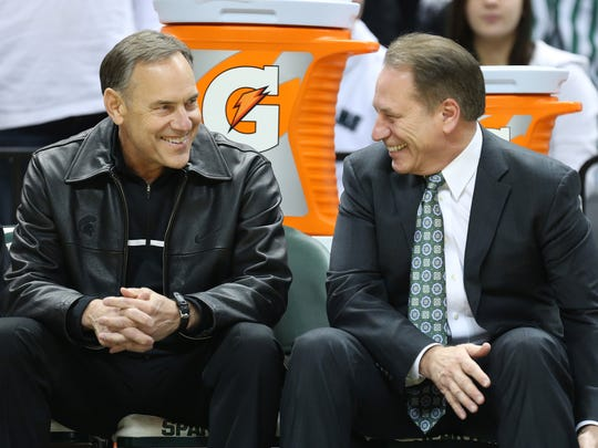 Football coach Mark Dantonio, left, and men's basketball coach Tom Izzo have the Spartans in the top 6 in of both Associated Press Top 25 polls this week.