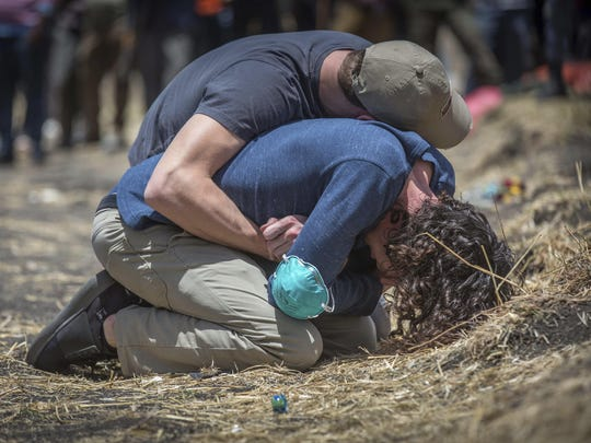Relatives react at the scene where the Ethiopian Airlines