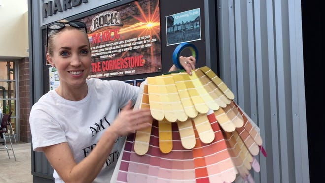 Event chairperson and designer Tara Woodend shows her paint-chip skirt.