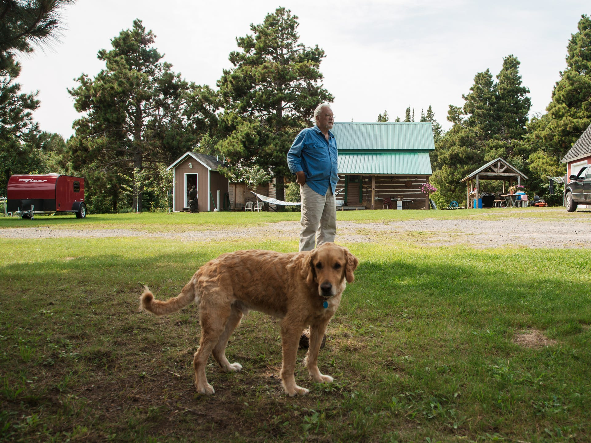 Jim Vivian, 74, stands with his dog in front of his
