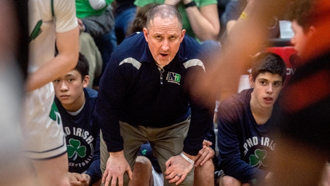 Peoria Notre Dame head coach Tom Lacher, shown here during a Class 3A regional victory over Washington in March, will get a look at his 2020-21 team this month in a series of exhibition games at East Peoria.