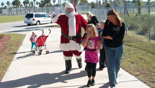 Bring your camera to take photos with Santa during Friday's Santa Fest at Wa-Ke Hatchee Recreation Center.