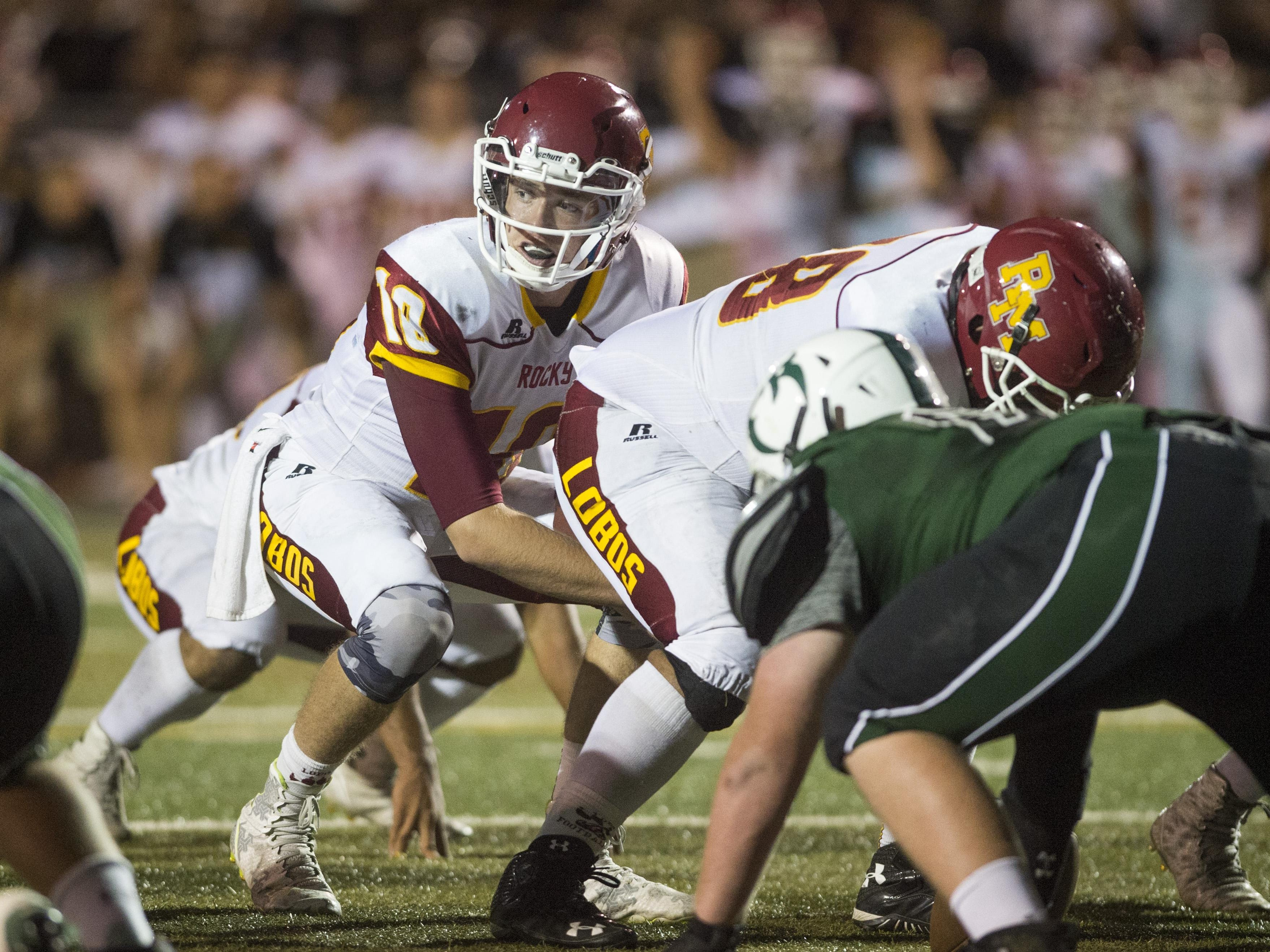 Rocky Mountain High School quarterback Tyler Hyland lines up for a play near the endzone in a game against Fossil Ridge Friday. The Lobos won 19-6.