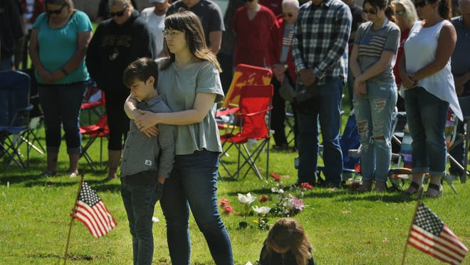 Cara Stephens with her son William and daughter Violet at the Memorial Day Commemoration service that took place at Simi Valley Public Cemetery Monday morning. People paid their respects to our fallen warriors who served in the armed forces during several wars.