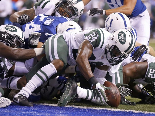 New York Jets cornerback Darrelle Revis (24) pulls in the loose ball after Indianapolis Colts running back Frank Gore (23) lost control during a run to the end zone, ultimately giving the ball up to the Jets on the play at the goal line, during the second half of a NFL Monday Night Football game, Monday, September 21, 2015.