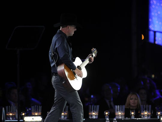 Kenny Chesney performs during the show at the 61st annual BMI Awards show November 5, 2013 in Nashville, Tenn.