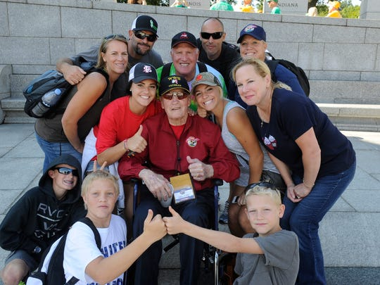 Family members surround World War II veteran Robert Pifferini, including his daughter, Trina Rettig of Visalia, at right, at the World War II Memorial in Washington, D.C. He is on the Central Valley Honor Flight out of Fresno and they flew separately to Washington to be with him at this memorial on Tuesday.