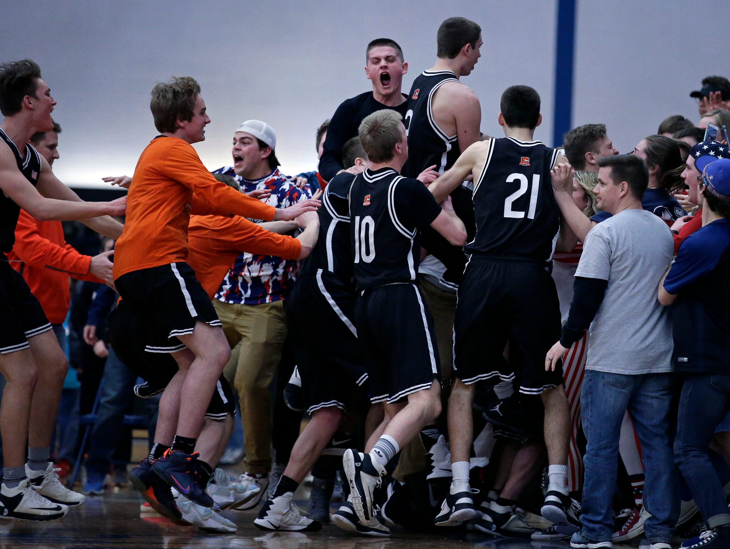 The Cedarburg Bulldogs celebrate with their fans after