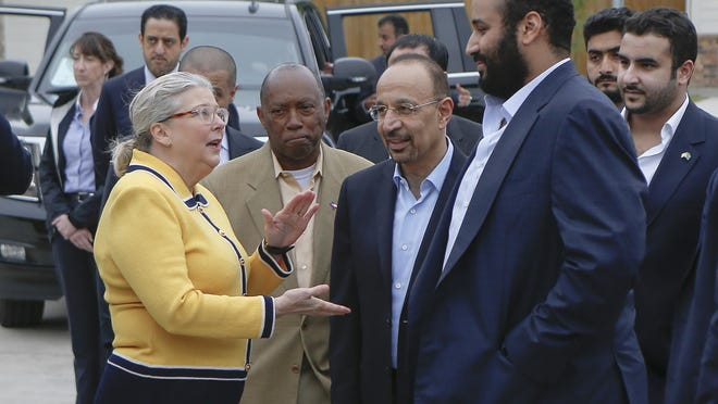 In this April 7, 2018, file photo, Saudi Crown Prince Mohammed bin Salman, right, is seen with his entourage as he tours a flood-damaged area in Houston, Texas. The man in the photo, rear second left, is allegedly the same individual in images that a pro-government Turkish newspaper published who was seen on surveillance video walking into the Saudi Consulate in Istanbul before writer Jamal Khashoggi vanished there.