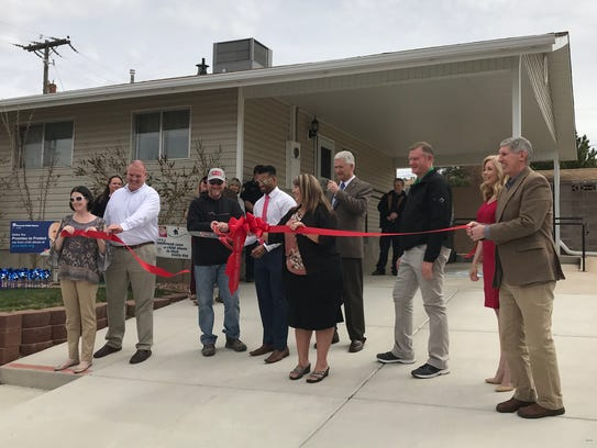 Officials celebrate the debut of new rooms at the Iron