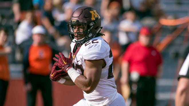 In this Saturday, Oct. 29, 2016, file photo, Minnesota running back Kobe McCrary (22) runs the ball for a touchdown during the fourth quarter of an NCAA college football game against Illinois at Memorial Stadium in Champaign, Ill. McCrary and two other players were cleared of sexual harassment allegations in the final round of appeals at the school and will be allowed to return to spring practice, while two more had their suspensions in connection with allegations of a sexual assault upheld. Provost Karen Hanson heard the appeals and upheld the decision to remove one-year suspensions for defensive back Antoine Winfield Jr., McCrary and quarterback Mark Williams, attorney Ryan Pacyga said Monday, March 20, 2017.