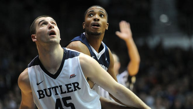 Butler forward Andrew Chrabascz battles Villanova forward Tom Leibig for a rebound.