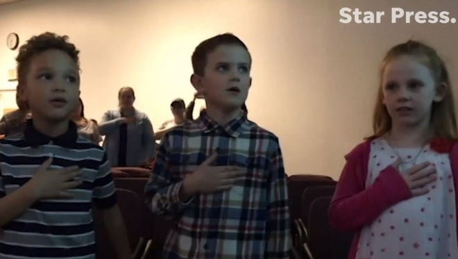 West View Elementary kindergartners recite the Pledge of Allegiance in two languages at Tuesday's school board meeting. The school introduced a program to teach kids how to become bilingual and bilterate in English and Spanish