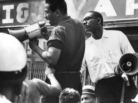 U.S. Rep. John Conyers tries to calm the crowd that had gathered at 12th and Clairmount streets in Detroit as the1967 unrest broke out.