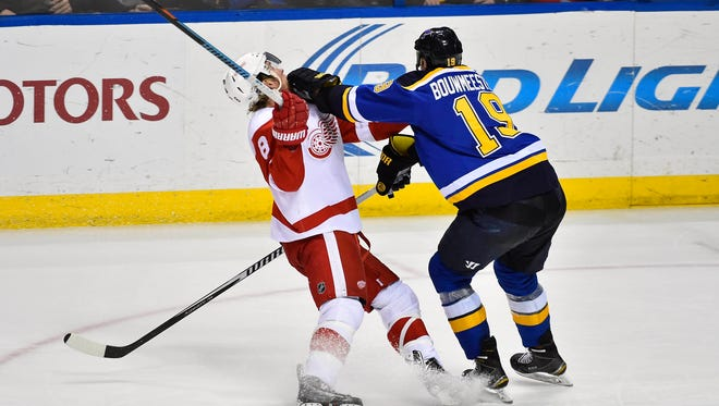St. Louis Blues defenseman Jay Bouwmeester (19) checks Detroit Red Wings left wing Justin Abdelkader (8) during the third period at Scottrade Center.