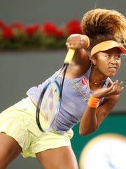 Naomi Osaka plays against Simona Halep in their semifinal